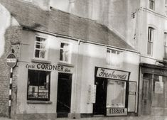 These were four of the finest and oldest buildings in West Street which were demolished in the 1960's development plan. Cordner's Bike Shop; (17th C); Freeburne's Confectioners; (17th C) ;Courtney's Groceries; Bennett's Pub.  Kindly loaned by Sheila Whysall (nee Freeburne) Portadown Various Photos P6