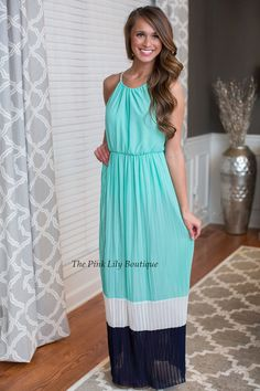It will look like you're walking on air in this stunning maxi! From the colors to the pleated look, we are just obsessed!