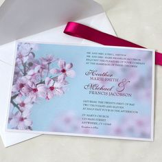 Cherry Blossom Wedding Invitation — Features a close-up photo of delicate cherry blossoms against a blue sky. I choose the color cranberry to highlight the couples names and to this elegant design. Mounted on a crystal metallic mat with a cranberry satin ribbon belly band to add that finishing touch. Invitation measures 5 x 7 and uses an A7 envelope. Response card measures 3.5 X 5 and uses an A2 envelope. Could be a beautiful bridal shower invitation as well.  :: Minimum order quantity of 25…