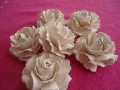This is an easy, step by step tutorial showing how to make gorgeous handmade paper roses that can be used to embellish crafts, handmade cards and more.