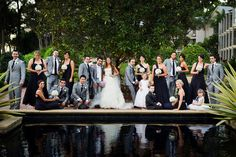 I like the creative posing of this large bridal party