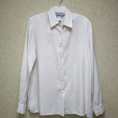 Pendleton silk blouse 100% silk in a beautiful herringbone weave (pic2). Has shoulder pads which can easily be removed.  Classic style. Inside of neck shows very slight wear and there is a tiny spot on cuff which is visible in pic 4.  Otherwise perfect. Ivory color. Pendleton Tops Blouses