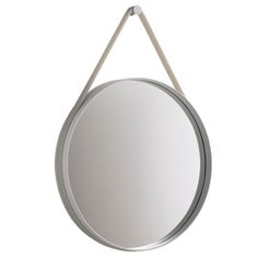 Strap is a playful mirror from Hay. Strap mirror is round and has a frame in powder coated steel and a silicone strap to hang it on the wall.