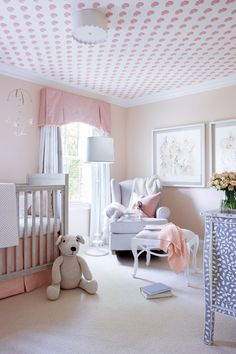 """""""We wanted it to be girly without it being over the top,"""" says Katz of her daughter's pink-hued nursery. The crib is by RH, with a custom-made skirt in a Rogers & Goffigon glazed linen. The chair is by Pottery Barn."""