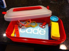 Use a cake carrier to store play-doh and play-doh supplies. Toddler friendly for storage and clean up!