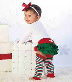 She'll look adorable in Ruffly Rumps Holiday Bloomers & Legwarmers. The festive set is wonderful for pictures and family parties. The bloomers fit over a diaper and give any outfit extra color. It features an elastic waist and cuffs, as well as 3 tiers of ruffles. Stretchy, coordinating legwarmers also have ruffled cuffs. Get your adorable little angel this gorgeous set and dress her for the season!