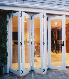 Folding patio doors from kitchen dining room to the outside Sliding French Doors, French Doors Patio, Screened Porch Designs, Backyard Patio Designs, Window Design, Door Design, House Design, Folding Patio Doors, Three Season Room