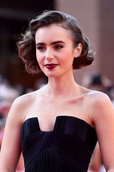 Lily was the picture of pinup perfection at the premiere of Love, Rosie at the Rome Film Festival with a wavy bob, vampy lipstick, and subtle purple eyeliner to match her gown. Short Wedding Hair Inspiration for Jenny Buckland Hair and Make up #shortweddinghair #shortweddinghairinspiration #weddinghairinspiration #shortweddinghairideas #weddinghair #shorthair