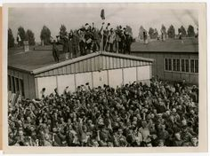 Prisoners at Dachau cheer their liberators. The original caption reads:  Horrors worse than those found in the German concentration camps of Buchenwald and Belsen were discovered in the stinking hell-hole of Dachau, captured by troops of the 42nd and 45th Infantry Division of the Seventh U. S. Army April 30,1945. More than 32,000 prisoners were liberated, among them some Englishmen, Canadians, and Americans. history-geek-well-mostly-wwii