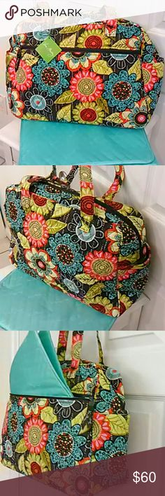 Baby bag by Vera Bradley NEW Brand new diaper bag by Vera Bradley.  Large front zip pocket, pockets on each end for bottles, and easy clean polyester lining inside.  Comes with an orange changing pad.  This is the Baby Bag in Jazzy Blooms, large flowers in shades of pink, orange and yellow.  I have several diaper bags available. Vera Bradley Bags Baby Bags