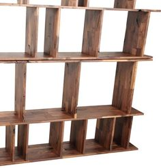 The Monument Bookshelf is a true masterpiece. Crafted from solid walnut, this large display unit has multiple compartments in various shapes and sizes that allow for an impressive visual display. Ship