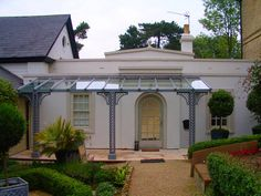 A Verandah on a beautiful Georgian single-storey building in Kent; standard lattice columns with Quarter arches; 6 x 2m.