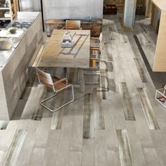 A modern take on the gritty appeal of concrete perfect for both residential and high-traffic commercial projects. Stone Mosaic, Stone Tiles, Dark Tile Floors, Large Format Tile, Granite Tile, Poured Concrete, Tile Installation, Porcelain Tile, Fresco