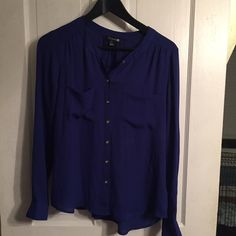FOREVER 21 S blue blouse This is my favorite color blue. I think it looks good on everyone. Lightweight blouses are so easy and comfortable to wear. It has buttons down the front you can keep as a blouse or open it up and add a tank under! Forever 21 Tops Blouses