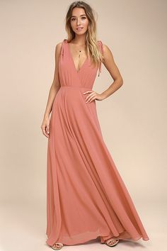 Every twirl you take in the Dance the Night Away Rusty Rose Backless Maxi Dress will be absolutely magical! Woven poly forms wide straps, with tying detail and hidden no-slip strips, that flow into a surplice bodice. A sweeping maxi skirt falls below a backless silhouette and fitted waist. Hidden back zipper/clasp.