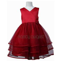 V-Neck Tiered Organza Flower Baby Dress: This classic red organza flower baby dress features a sensational sleeveless style with a triple layer skirt. This beautifully simple red organza knee length dress comes with a adjustable sash tie in the back. Like many of our special occasion dresses, it is versatile and can be used as a flower baby dress, pageant dress, or even as a holiday party dress. No matter the occasion, this will make your little baby even more adorable and irresistibly…