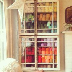 Yarn stashed inside old windows.