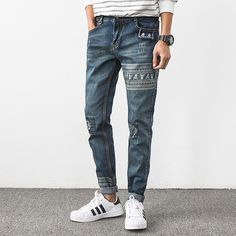 bd3a4adc4f2e New Fashion Mens Skinny Jeans Ripped Knee Patch Skulls Print Denim Pants Men  Korean Style Stretch Male Trousers Slim Fit Jeans -in Jeans from Men s  Clothing ...