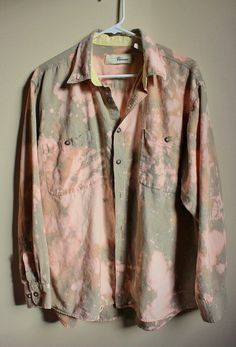 This is a soft vintage 90s light khaki shirt.  Weve strategically splatter bleached it all over and distressed/ frayed it along the bottom hem.  Heres your info on it -  - Size Large, check measurements - Across chest flat, pit to pit - 25 (50 around)  - Shoulder seam down, front - 27  - Shoulder seam down , back - 28  - Shoulder seam to cuff - 23  If you need more info or have any questions, just yell, were around to help you out.  If youre ordering from a location not listed, message us…