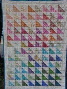 Rainbow Half Square Triangles by susan mz fuller, via Flickr