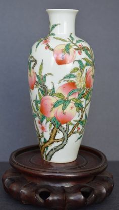 A Superb Famille Rose Peach Guan Yin Vase. 19th Century, H: 8 in. Nine peaches and three bats drawn vividly on the vase. Qianlong Mark on the bottom.
