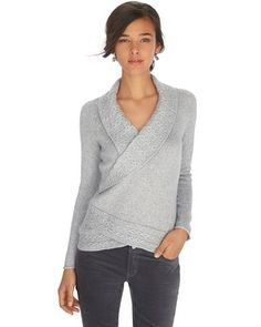 Classic pullover with cable knit details is polished and pretty with surplice neckline, crossover hem and a touch of lurex luster, taking it straight to the top of our must-haves list.