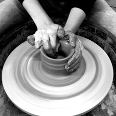Sitting at the wheel making pottery.  One of my favorite things to do. <3