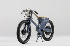 deus electric custom motorcycle is highlighted with copper  www.designboom.com