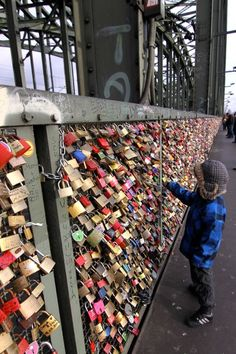 Love Lock Bridge in Cologne, Germany. Lovers carve their initials into the locks and then attach the lock to the bridge.