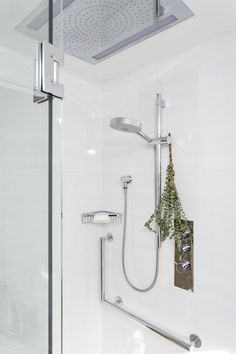 Winter home decor tip: Hang a few sprigs of eucalyptus in your shower. The steam will release the essential oils of the plant, which is known to help ease congestion and let you breathe easier.  Pictured: Our British Properties Residence project.