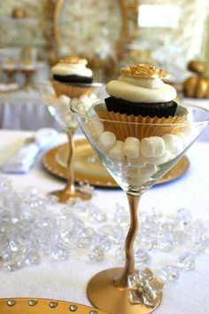 champagne glass filled with marshmellows and a cupcake.