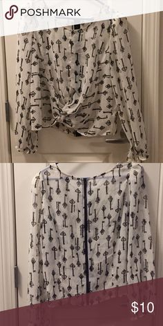Top with keys White top with. Black antique skeleton keys and a zipper up back. Like new!  Bundle to save !!! Forever 21 Tops Blouses