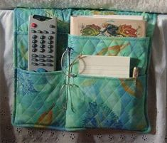 Bed pocket organizer - seems a quilted piece holds it's shape better than non-quilted. Sturdy material would be best. Bed Organiser, Bedside Organizer, Bedside Caddy, Pocket Organizer, Baby Turban, Turban Hut, Bedside Pocket, Bed Pocket, Remote Caddy