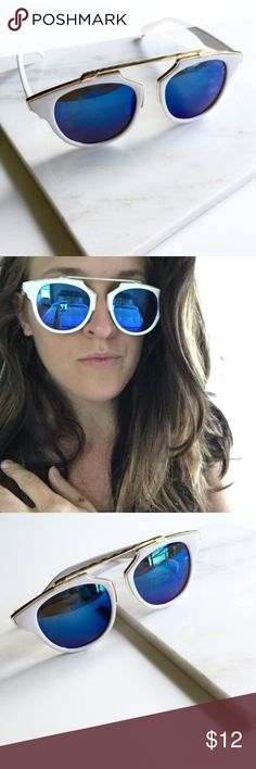 """NWT    Blue Mirrored So Real Cat Eye Sunglasses So cute, so fun. Get the So Real look without the price. White Matte frames with blue mirrored lenses and gold metal accents and brow bar. 100% UV protection. 5.8"""" W x 2.1"""" H. Price is firm unless bundled. Bundle 4 or more and save 20%. Accessories Sunglasses"""