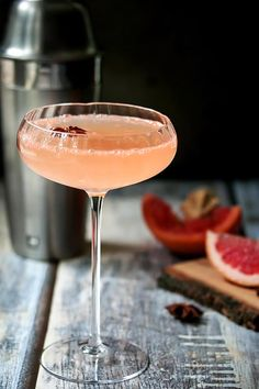 A grapefruit martini made with grapefruit juice, ginger infused simple syrup, lime juice, grated ginger, star anise, rhubarb bitters and a touch of bubbly. .