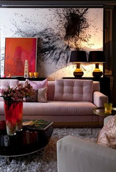 A really interesting colour palette......and i love the pairing of the lamps and other accessories in the room