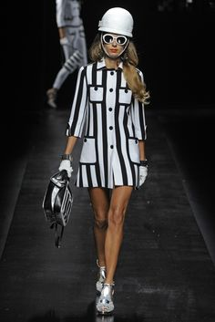 13. Moschino RTW Spring 2013 - Slideshow - Pop art influenced that was popular in the 1960s like the modrian dress. Influenced by wearable art with the geometric lines from the 60s.