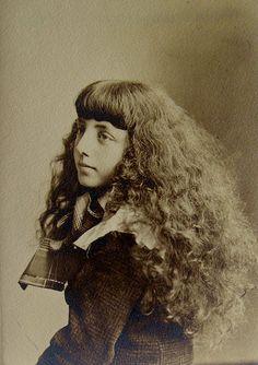 Girl with a Cloak of Wild Hair by WonderfullyStrange, via Flickr