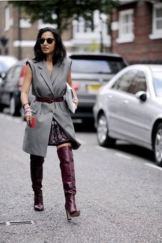 This woman styled her leather boots in a cool, business casual way with a long, belted vest layered over a print skirt. Description from spydernews.com. I searched for this on bing.com/images