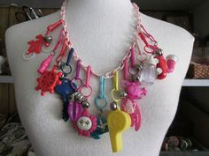Vintage 1980's Plastic Bell Charm Necklace with 13 Charms, Excellent Condition