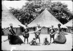 MANGBETU, PLAYING SONG ON CARVED IVORY HORN. Locale: OKONDO'S VILLAGE, CONGO BELGE