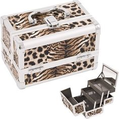 "Cosmetic Makeup Train Case with Mirror and Extendable Trays Color: Brown Leopard by Just Case. $39.95. M1001LPBR Color: Brown Leopard Features: -Two pull out drawer with plastic lining for easy cleaning.-One large mirror which doubles as a lid.-Swivel handle top.-Easy to clean interior.-Secure easy close latch. Construction: -Constructed of high quality aluminum and reinforced steel corners for extra durability. Dimensions: -Space underneath trays when closed dimensions: 2.25"" H ..."