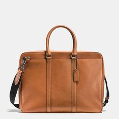 The classic Bleecker Brief is updated for the modern businessman in hand-burnished leather that complements the streamlined design with a vintage look and feel. Its trim silhouette is spacious enough for a laptop or iPad, with soft leather handles and a detachable shoulder strap for comfort and versatility.