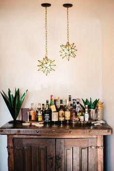 Bar island with aloe plants and moroccan pendant lighting.