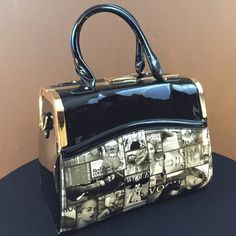 Celebrity Satchel Black and white with gold tone hardware magazine satchel. Super roomy inside w/cellphone/ keys pockets and inside side zipper pocket. Comes with shoulder strap for ease of use. Bags Satchels