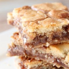 Gooey Cake Mix Cookie Bars ~ The recipes calls for a mix of Peanut Butter & Choc Chips for the center...I think I will use Butterscotch!