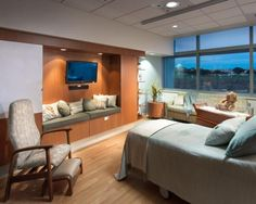 A labor/delivery/recovery room features plenty of space for family members, plus an attractive wall and large window. There's also ample storage and shelving for personal belongings. Photo: Ed LaCasse.