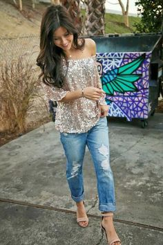 I just love this glittery top with these boyfriend jeans.