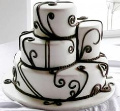 Very modern Halloween Vow Renewal cake in black and white