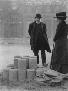 Selling Stilton cheese in the market 1903